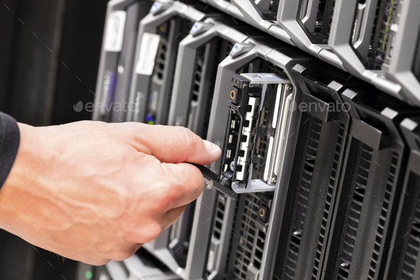 IT Technicians Repairing Harddrive on Server At Data Center - Stock Photo - Images