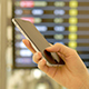 Playing a Smartphone in The Airport - VideoHive Item for Sale