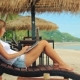 Young Woman Freelancer Sitting at the Sunbed with a Laptop - VideoHive Item for Sale