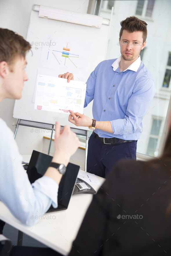 Confident Professional Showing Chart To Colleagues - Stock Photo - Images