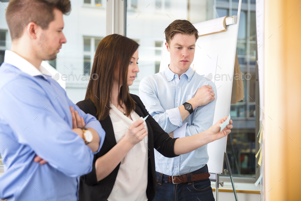 Coworkers With Adhesive Notes Standing In Office - Stock Photo - Images