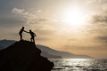 Teamwork couple climbing hiking with helping hand - PhotoDune Item for Sale