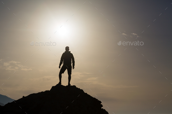 Man looking and celebrating sunrise and landscape - Stock Photo - Images