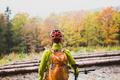 Mountain biker looking at inspiring forest landscape