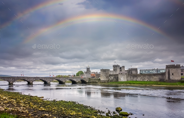 Rainbow over King Johns Castle - Stock Photo - Images