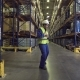 Worker Dancing Between Racks in Warehouse - VideoHive Item for Sale