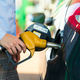 Woman fills petrol into the car at a gas station - PhotoDune Item for Sale