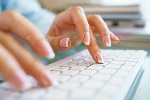 Woman office worker typing on the keyboard - Stock Photo - Images