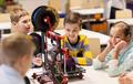 happy children with 3d printer at robotics school