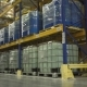 Man on Forklift Transporting Cargo in Warehouse
