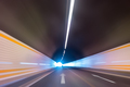 highway tunnel with car driving motion blur