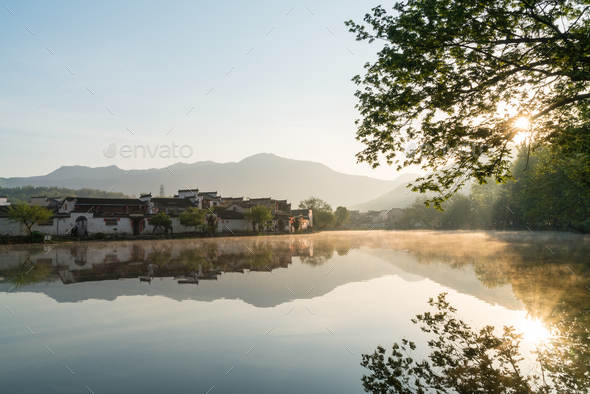 chinese ancient villages in sunrise - Stock Photo - Images