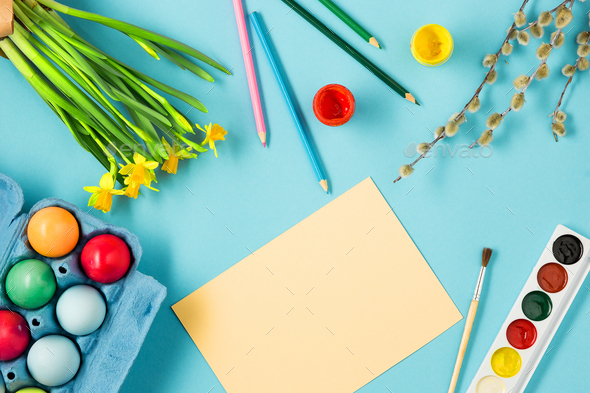 The top view of easter on blue table office workplace - Stock Photo - Images