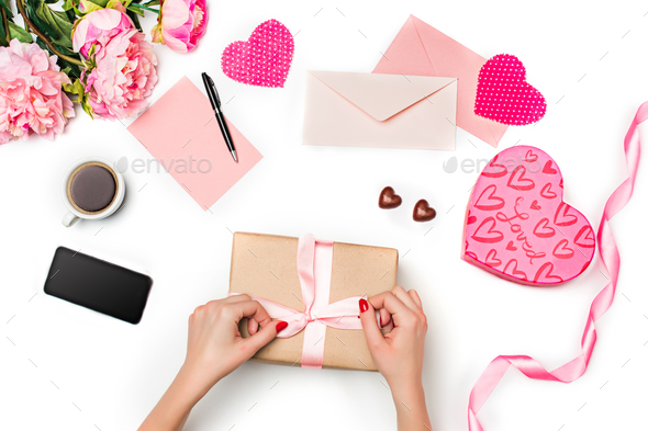 The female hands with gift box on white background - Stock Photo - Images
