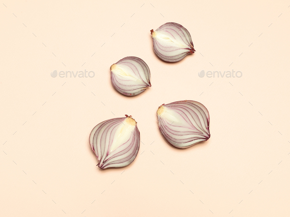 Red onion on a yellow background - Stock Photo - Images