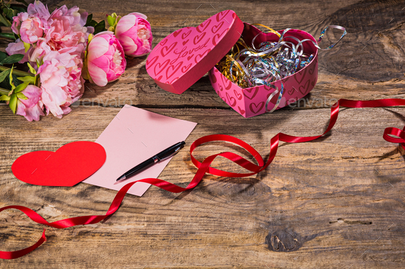 The gift box with hearts on wooden background - Stock Photo - Images
