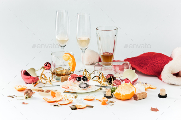 The morning after christmas day, table with alcohol and leftovers - Stock Photo - Images