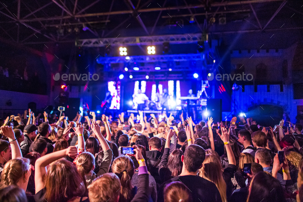 The silhouettes of concert crowd in front of bright stage lights - Stock Photo - Images