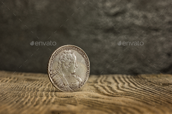 Closeup of old russian coin on a wooden background. - Stock Photo - Images