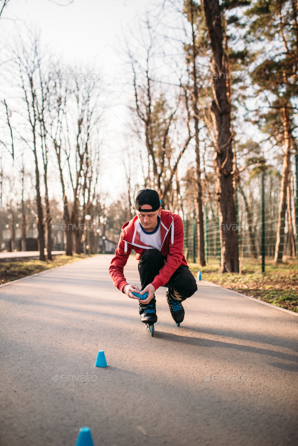 Roller skater in skates, balance exercise - Stock Photo - Images