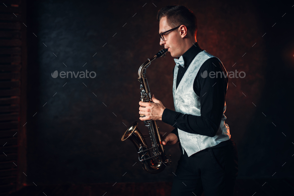 Male saxophonist playing classical jazz on sax - Stock Photo - Images