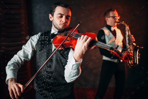Jazz man and violinst, classical musical duet - Stock Photo - Images