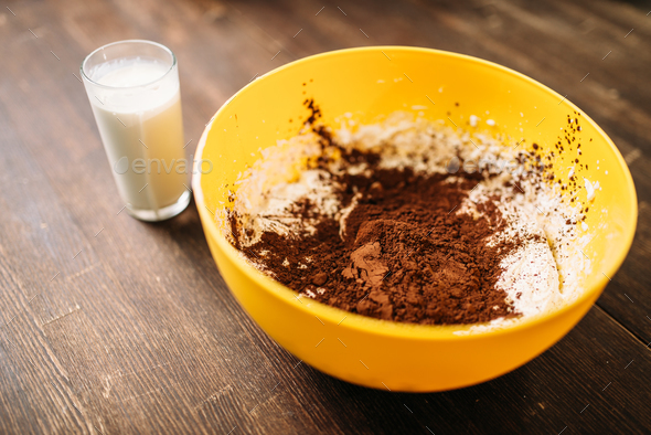 Bowl with dough, chocolate powder, glass of milk - Stock Photo - Images