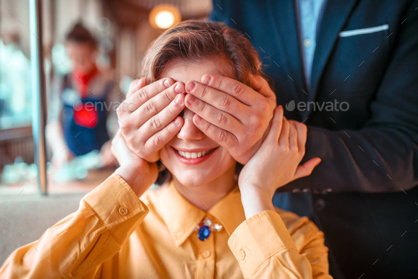 Male person closes eyes hands to beautiful woman - Stock Photo - Images