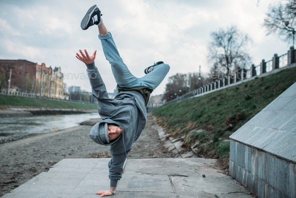 Breakdance performer, upside down motion on street - Stock Photo - Images