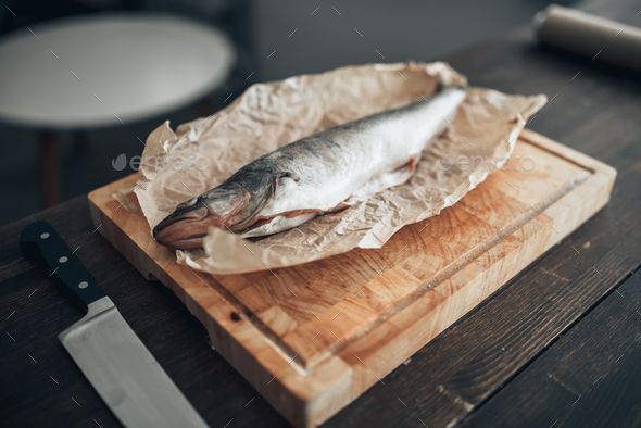 Fresh fish preparation on cutting board, closeup - Stock Photo - Images