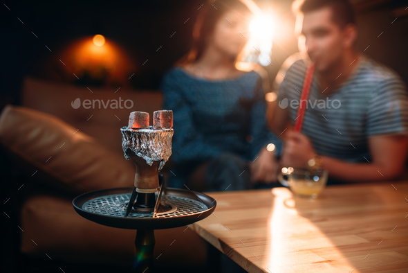 Red-hot coal on hookah in night club - Stock Photo - Images