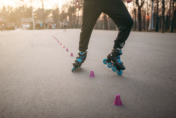 Rollerskater, rollerskating trick exercise in park - Stock Photo - Images
