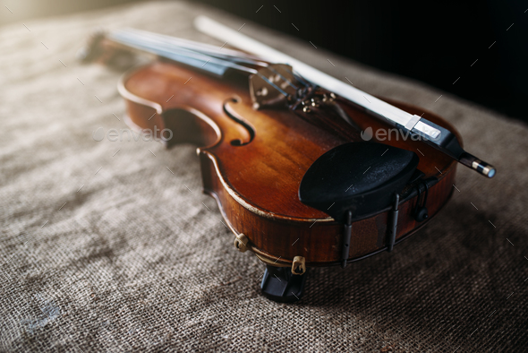 Violin, fiddlestick and bowtie, canvas background - Stock Photo - Images