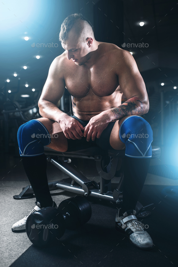 Muscular male athlete lifting dumbbells - Stock Photo - Images