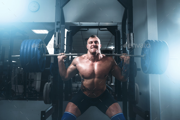 Strong athlete exercise with weight in fit gym - Stock Photo - Images