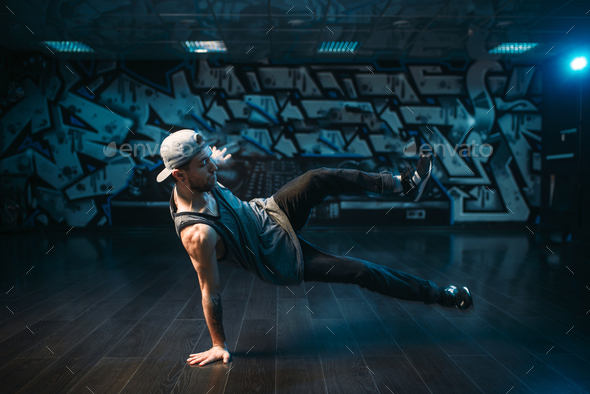 Young breakdance performer dancing in studio - Stock Photo - Images