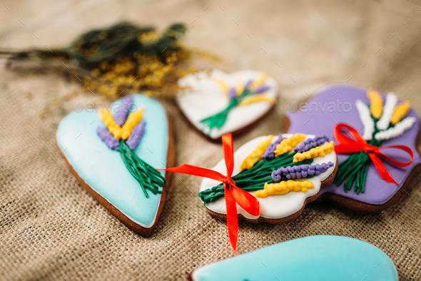 Cookies in glaze with pictures, burlap background - Stock Photo - Images