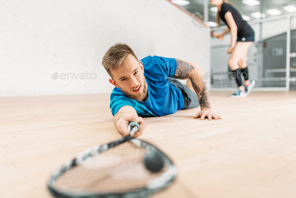 Squash training, player with racket lies on floor - Stock Photo - Images
