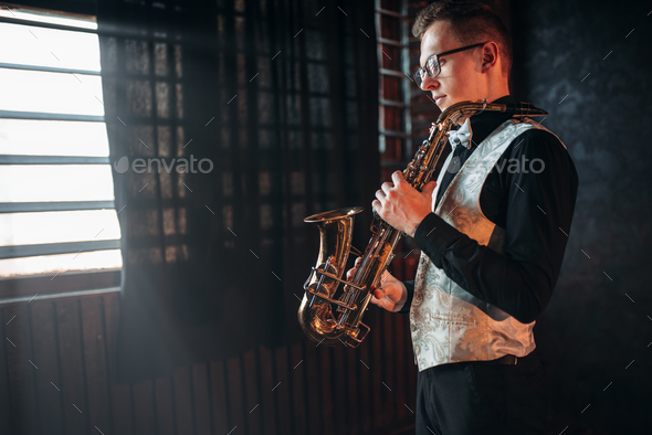 Male saxophonist with saxophone, jazz man with sax - Stock Photo - Images