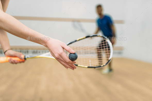 Couple play squash game in indoor training club - Stock Photo - Images