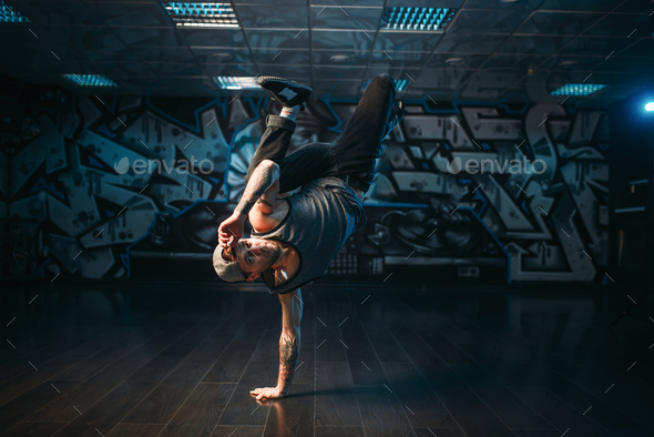 Breakdance performer posing in dance studio - Stock Photo - Images