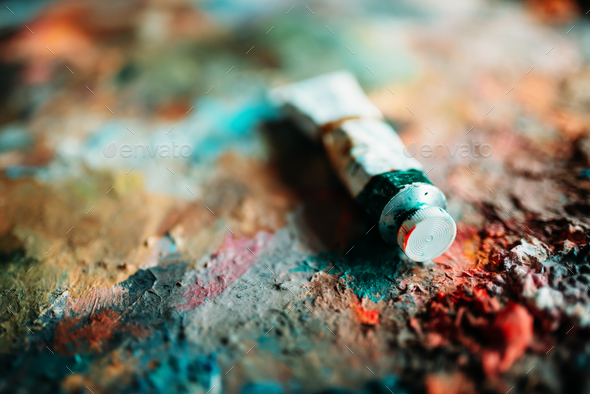 Paints mix and used tube on palette closeup view - Stock Photo - Images