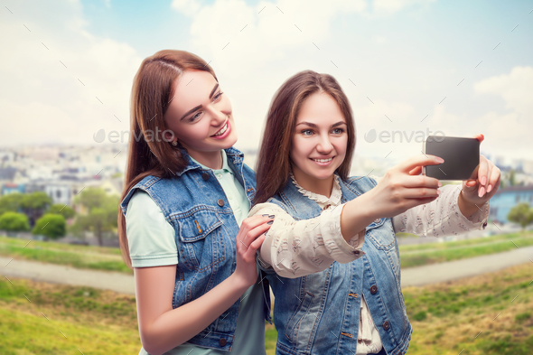 Girlfriends makes selfie, cityscape on background - Stock Photo - Images