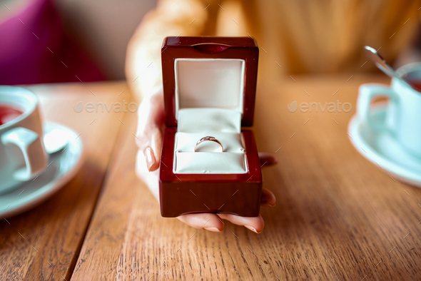Female person hand with golden wedding ring - Stock Photo - Images