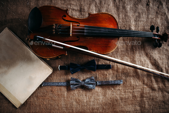 Violin, fiddlestick, notes and bowties closeup - Stock Photo - Images