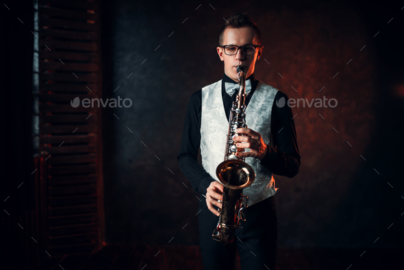Male saxophonist playing jazz melody on saxophone - Stock Photo - Images