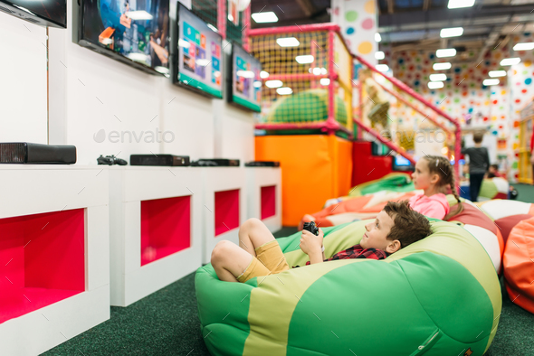 Kids play in a games console, happy childhood - Stock Photo - Images