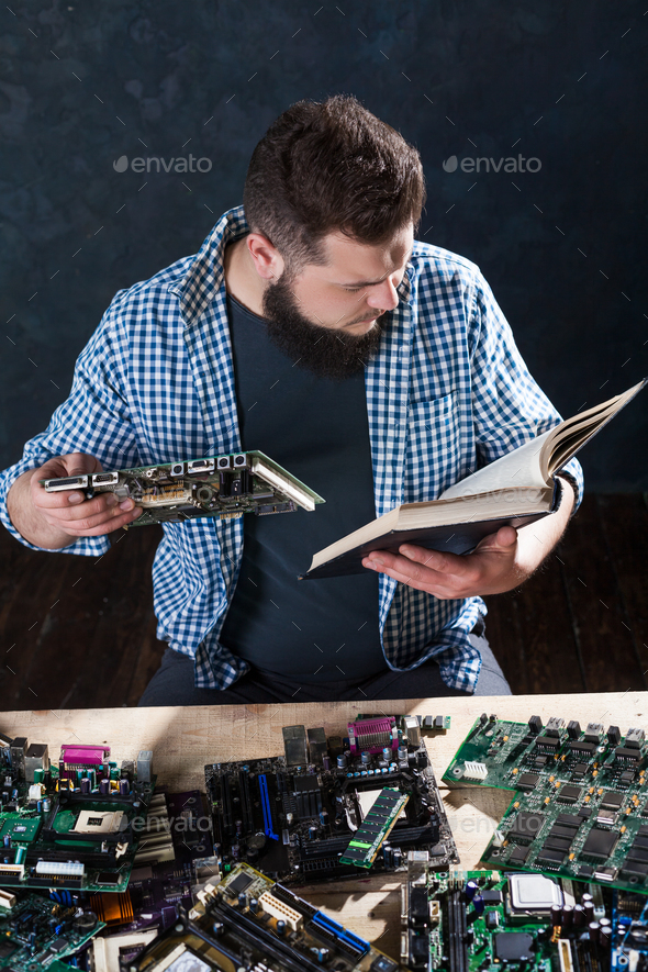 Electronic devices repairing and diagnostic techs - Stock Photo - Images