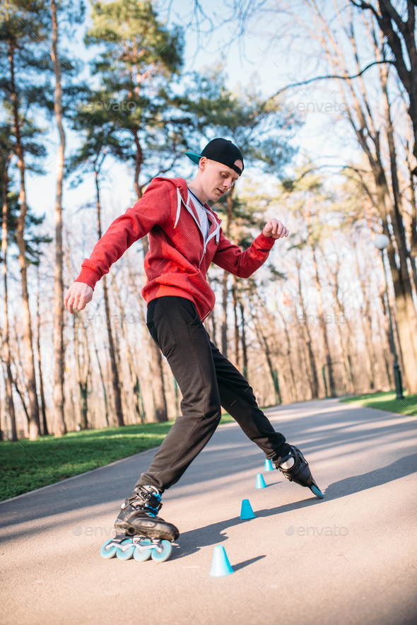 Roller skater, trick exercise in park - Stock Photo - Images