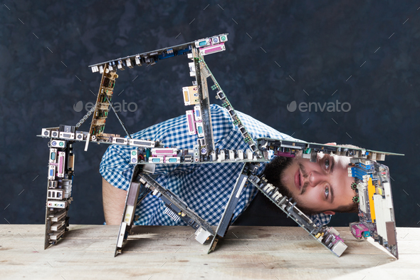 Engineer builds house of cards from motherboards - Stock Photo - Images